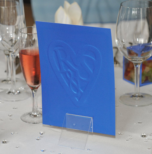 Menu Back embossed with Couple's 'Logo'